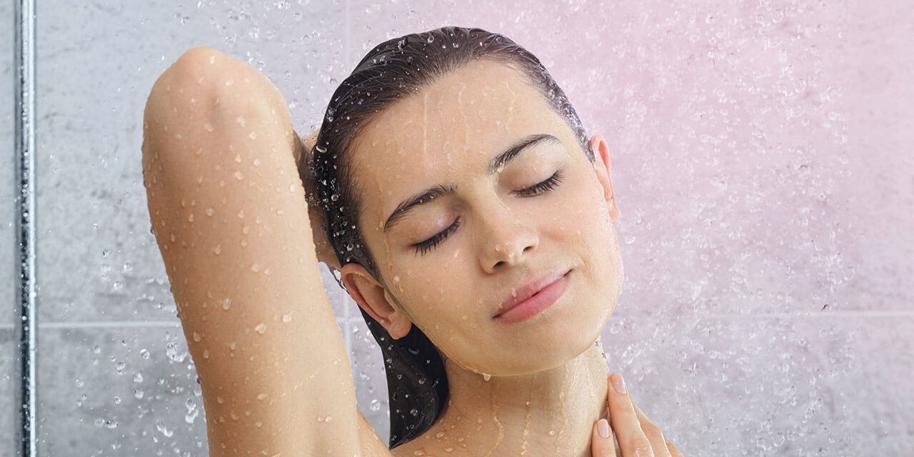 Woman enjoying a soft water shower