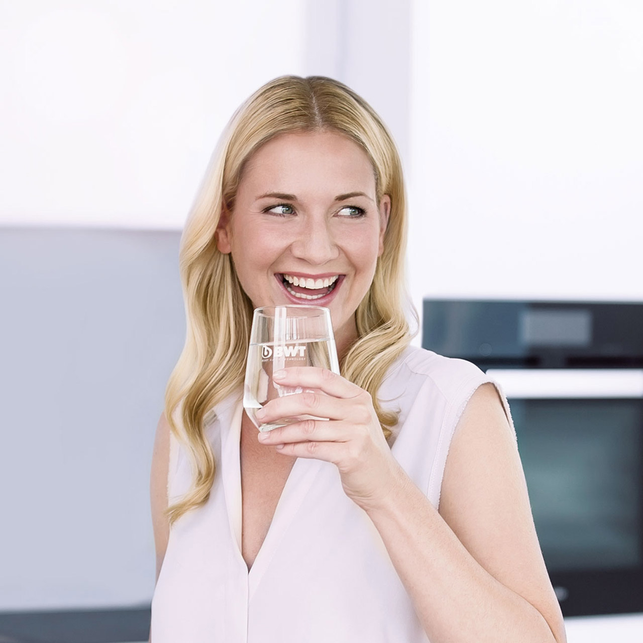 Woman enjoying a glass of mineralized water