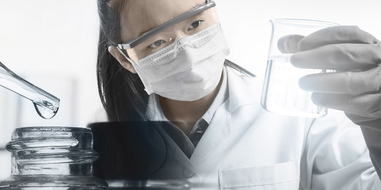Female chemist analyzing purified water